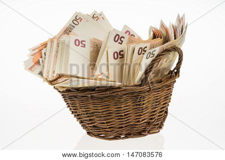 Fifty euro banknotes pile. Money bunch stack. Bill and brown basket on white background. Euros heap