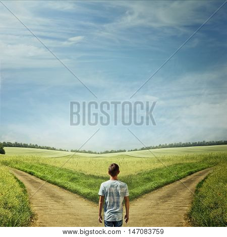 Creative concept with a man in front of two roads choosing the correct way