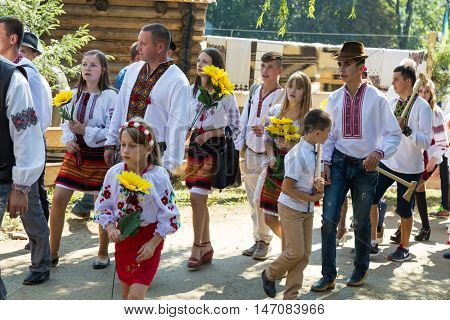4 September 2016. RakhivTranscarpathian region Ukraine. Celebration - Festival Hutsul brynza . Colorful procession - parade of people dressed in national costumes. Preservation of traditions and crafts manufacturing of cheese national food drinks.