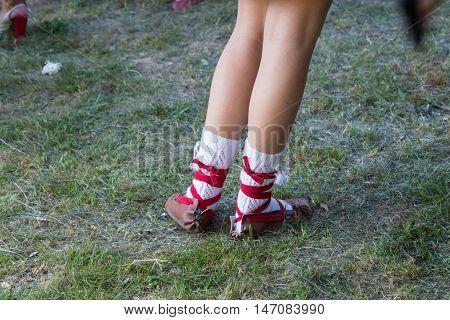 National Hutsul homemade shoes on girl feet