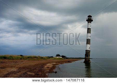 Skew lighthouse in the Baltic Sea. Stormy night on the beach. Kiipsaar Harilaid Saaremaa Estonia Europe.