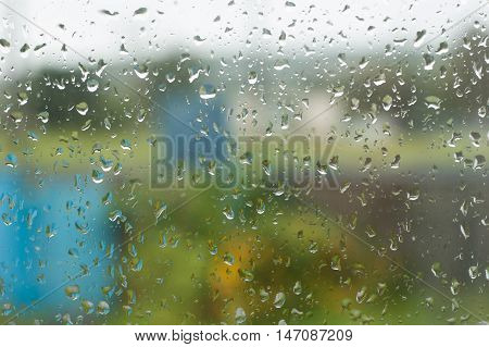 Raindrops on a window pane in the fall