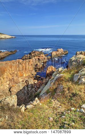 Beautiful landscape on rocky shore with blue sky