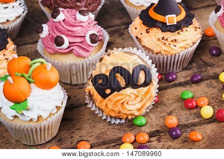 Halloween Cupcakes With Colored Decorations