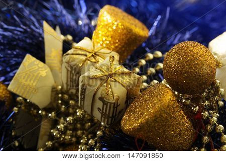 new Year decoration with Christmas gold balls and gift in golden box. Christmas ornaments christmas decoration. Christmas gold and green balls