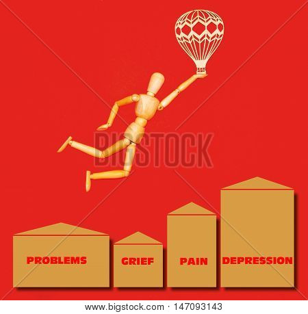 The wooden man flying over problems grief pain depression with airship on red background