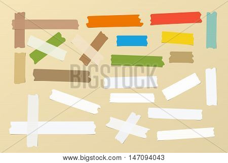 Pieces of different size, colourful, sticky, adhesive masking tape are on brown background.