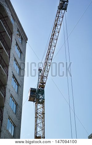 High-rise construction crane stands against the sky