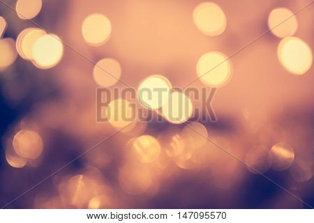 Toned bokeh with blinking Christmas lights in vintage style