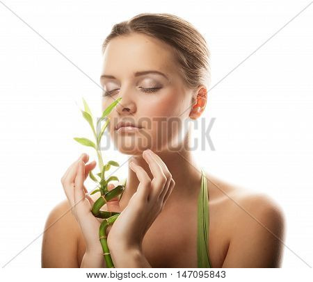 young beautiful woman with bamboo, isolated on white