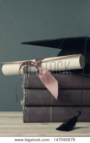 Graduation Mortarboard, Degree Scroll And Books - Faded Tones