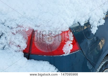 The back light of a snow covered car
