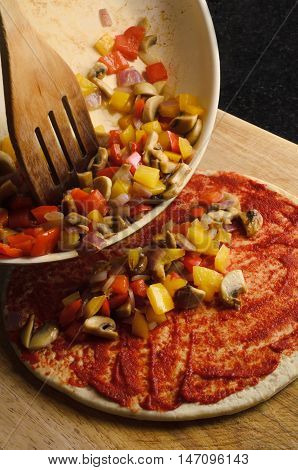 Pizza Making - Tipping Vegetables On To Base