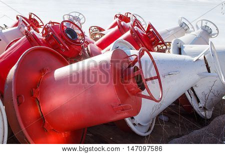 unnavigable period. red and white buoys on the shore in the winter. closeup