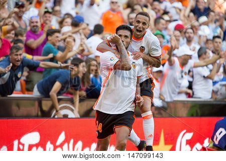 VALENCIA, SPAIN - SEPTEMBER 11th: Garay (L) and Rodrigo celebrating a goal during Spanish League match between Valencia CF and Real Betis at Mestalla Stadium on September 11, 2016 in Valencia, Spain