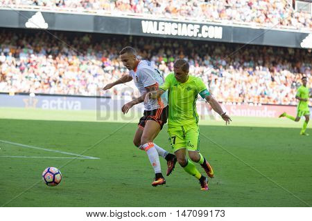 VALENCIA, SPAIN - SEPTEMBER 11th: (L) Rodrigo and Joaquin (R) during Spanish League match between Valencia CF and Real Betis at Mestalla Stadium on September 11, 2016 in Valencia, Spain