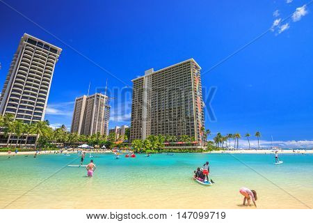 Waikiki, Oahu, HI - August 18, 2016: Hilton Hawaiian Village to the left of Duke Kahanamoku Beach. The beach is one of more popular of Waikiki Beaches because it offers a swimming area protected.