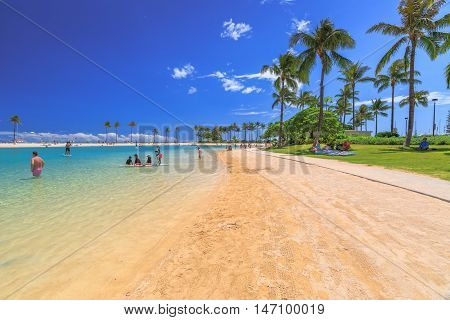 Waikiki, Oahu, HI - August 18, 2016: beach and lagoon at Hilton Hawaiian Village. The beach is one of more popular of Waikiki Beaches because it offers a calm swimming area with a protected seawall.