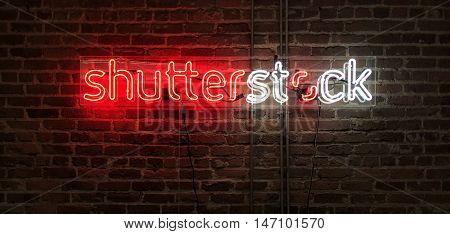 SAN FRANCISCO, CA - SEPTEMBER 2016: Neon sign of the Shutterstock logo glowing against an exposed brick wall in Shutterstock's San Francisco office.