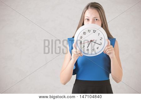 Woman Hiding Behind Clock