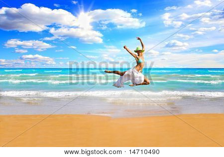 Beautiful young woman enjoying the Ionian sea in Greece