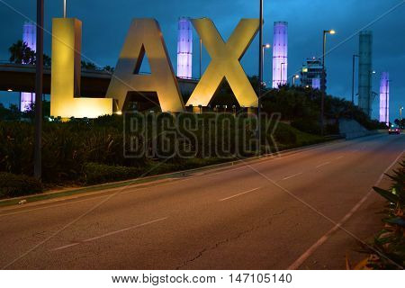 Los Angeles, CA - September 12, 2016:  Entrance to Los Angeles International Airport with a landmark LAX Sign and lit pylons beyond taken at Los Angeles International Airport (LAX) in Los Angeles, CA.
