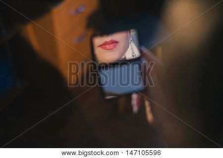 Reflection of female red lips in a mirror