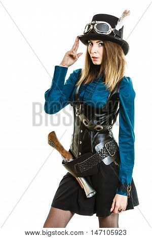Young steampunk islolated girl on white wearing fancy hat. Fantasy old fashion with stylish topper goggle and gun.