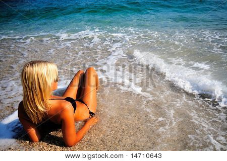 Beautiful young sexy model by the sea