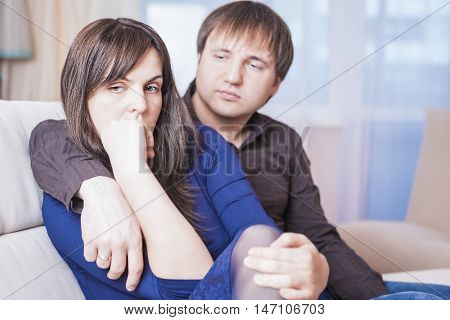 Family Concepts. Young Caucasian Couple in Troubles Having Difficulties and Depressed.Horizontal Shot