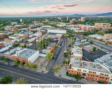 FORT COLLINS, CO, USA - SEPTEMBER 11, 2016: Downtown of Fort Collins, Colorado at late summer dawn  - aerial view with wide angle distortion and Rocky Mountains in background..
