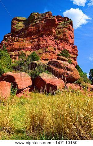 Red Rock Mesa next to grasslands taken in Red Rocks Park, CO