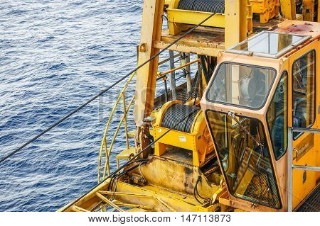 Cabin crane boom structure and metal sling on blue sky and sea background