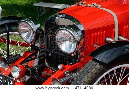 Kharkiv Ukraine - May 22 2016: Close up of retro car red Fiat Roadster manufactured in 1949 is presented at the festival of vintage cars Kharkiv Retro Rally - 2016 in Kharkiv Ukraine on May 22 2016