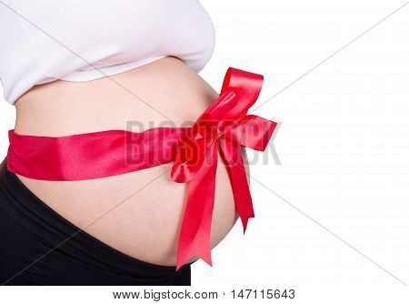Close Up Pregnant Woman With Red Ribbon Gift On Belly Isolated On White