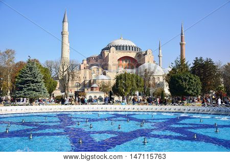 Istanbul, Turkey - November 11, 2014. Aya Sofya mosque in Istanbul, with fountain pool and people.