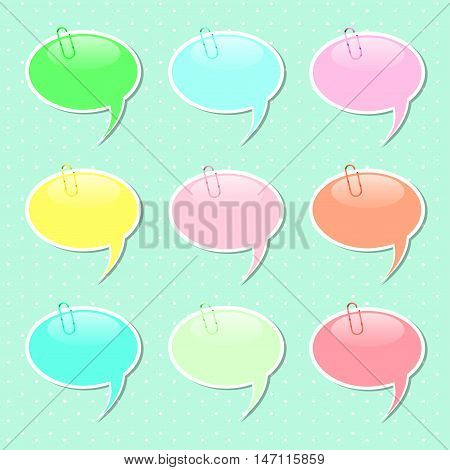 Speech Bubble paper sticker shapes with paper clips in pastel colors.