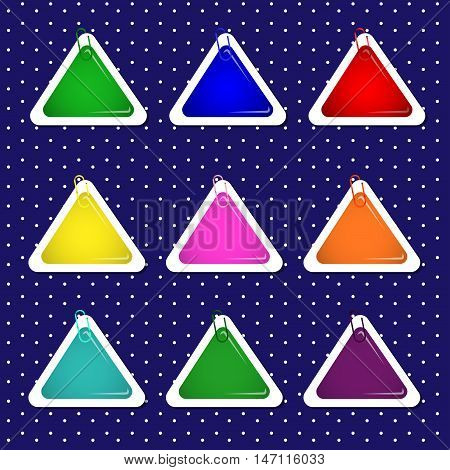 Triangle paper sticker shapes with paper clips in bright colors.