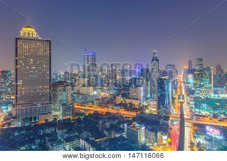 Bangkok Cityscape Business district with high building at night time Bangkok Thailand