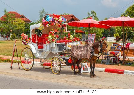 LAMPANG THAILAND-October 25:The horse carriage in Lampang at Wat Phra That Lampang Luang Lampang province on October 25 2015 in LAMPANG THAILAND.