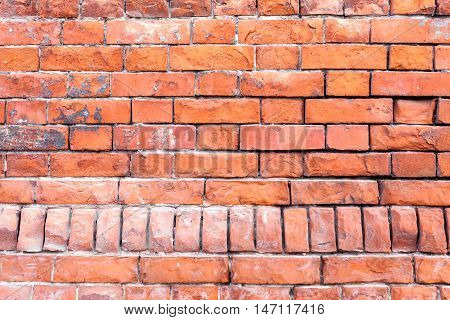 Brick wall of the old red brick. The texture of a brick wall. The horizontal masonry. Texture as background with a copy of the space.