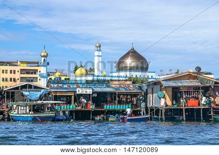 Semporna,Sabah-Sept 10,2016:Semporna bajau traditional water village with background of Ar Rahman Mosque Semporna is a popular tourist attraction at Semporna,Sabah,Borneo,Malaysia.