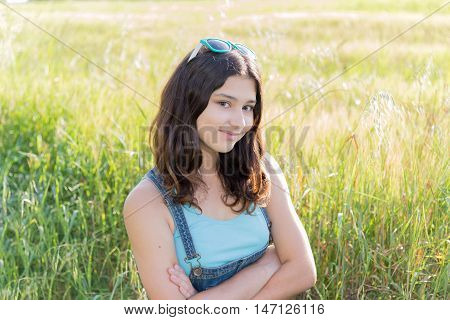 Portrait of a teen girl outdoors in summer