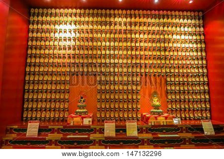 SINGAPORE, REPUBLIC OF SINGAPORE - JANUARY 09, 2014: Hall of the One Hundred Buddhas. Interior of the Buddha Toothe Relic Temple, Chinatown, Singapore city
