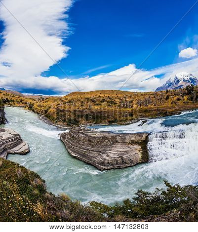 Chile, Paine Cascades. National Park Torres del Paine National Park - Biosphere Reserve. Cold water is emerald Paine river forms a cascading waterfalls