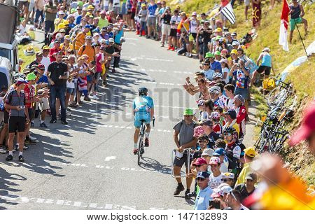 Col du Glandon France - July 23 2015: The Kazakh cyclist Dmitriy Gruzdev of Astana Team riding on the road to Col du Glandon in Alps during the stage 18 of Le Tour de France 2015.