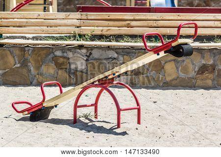 Children's playground, swing in the sand, summer