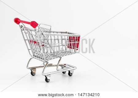 Red shopping cart isolated on white background