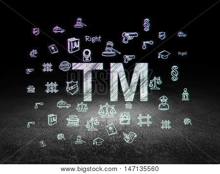 Law concept: Glowing Trademark icon in grunge dark room with Dirty Floor, black background with  Hand Drawn Law Icons