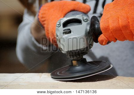 Worker Polishing A Wood Table. Close-up